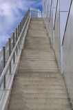 Stairway to heaven. A new set of concrete steps with thick safety glass and stainless steel handrail Royalty Free Stock Photo