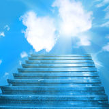 Stairway to heaven. Stairs towards sun on the blue sky with clouds Royalty Free Stock Image
