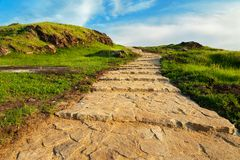 Stairway to heaven. Stone stairway to heaven. Stairs up the green hill Royalty Free Stock Images