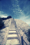 Stairway to heaven. Stairway up to the peak  and deep blue sky Royalty Free Stock Photo