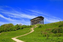 Stairway to Historic Penshaw Monument. The historic monument of Penshaw on a large hillside with mass of changing colours and shades of green.Trees and bush's Royalty Free Stock Image