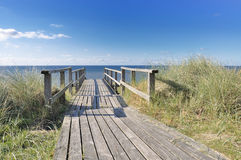 Stairway to the ocean. With blue sky and clouds at Sylt near Westerland Royalty Free Stock Images