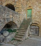 Stairway to old house. Lisle sur Tarn, Midi Pyrenees, France - September 24, 2017:  Old stone house with green door access staircase Royalty Free Stock Photo