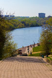 Stairway to the river. The staircase leading to the embankment of the river blue, surrounded by trees Stock Photography