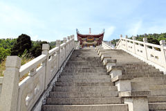 Stairway to salvation. An image of concrete staircase up to an ancient Chinese temple stock photo