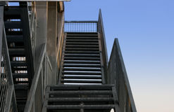 Stairway to the sky. A picture with an original perspective showing an emergency metal stairway Stock Photos