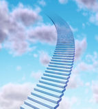 Stairway to the sky. And rise to the top as a success in business promotion and financial profits concept with stairs going up to the blue clouds fading  high Stock Photos