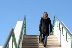 Stairway to the sky. Woman climbing stairs Stock Photos