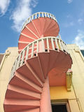 Stairway to the sky. Curved spiral stairs leading to the blue sky with clouds Royalty Free Stock Photo