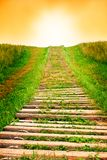 Stairway to sky. Old wooden stairway stretching into the sky Stock Images