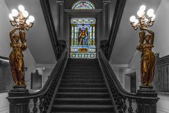Stairway to the stain glass window at the union league. Stain glass window adorns the hall way of philadelphia`s union league on broad street Royalty Free Stock Images