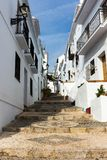 Stairway up a hill in a white village in andalusia, spain. Royalty Free Stock Photo