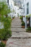 Stairway up a hill in a white village in andalusia, spain. Stock Photos