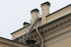 Stairway up on the roof. A ladder to the skies on the roof Royalty Free Stock Photos