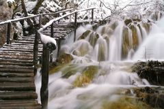 Stairway up the waterfall. Snowy winter day in Park Plitvice, Croatia Royalty Free Stock Photos