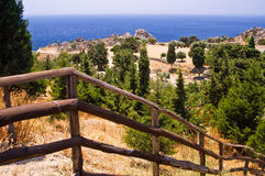 Stairway with a wooden fence to the coast of Lybian sea, island of Crete Stock Photo