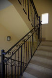 Stairway and Wrought Iron Bannister. A stair well with wrought iron bannister Stock Images