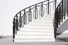 Stairways and fence. White stairways and black ornate fence Royalty Free Stock Photo