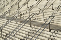 Stairways and handrails. Large stairways with metal handrails and shadows Stock Photos