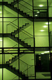 Stairwell. Staircase at night, in fluorescent green light royalty free stock image