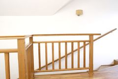 Stairwell. Wooden staircase with loft_indoor Royalty Free Stock Image