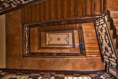 Stairwell of an ancient palace, seen from the ground floor to the top. royalty free stock photos