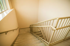 Stairwell and emergency exit in building Stock Photo