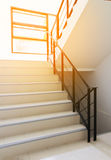 Stairwell fire escape in condominium, apartment or modern building with sun rays. Or sun flare stock photography