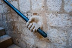 Stairwell with hand shaped detail. A stairwell with a hand rail with a hand-shaped detail in Dubrovnik, Croatia Stock Photography