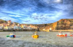 Staithes North Yorkshire England uk with boats in harbour in colourful hdr stock photography