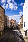Staithes, North Yorkshire, UK. A view looking down High Street. Staithes, North Yorkshire, UK. A view looking down the village High Street towards the harbour royalty free stock photography