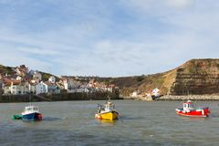Staithes Yorkshire boats in the bay Stock Image