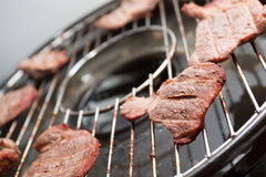 Stake on bbq grill Stock Photos