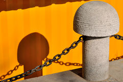 Stake with chain and shadow Royalty Free Stock Images