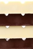 Stake of different chocolate bars. Royalty Free Stock Photography