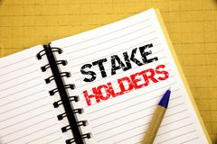 Stake Holders. Business concept for Stakeholder Engagement written on notepad with copy space on old wood wooden background with p. Stake Holders. Business royalty free stock image