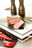 Stake on lava-stone. With chili Royalty Free Stock Photo