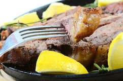 Stake from mutton with a lemon Stock Photography