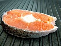 Stake of salmon on pan Royalty Free Stock Image