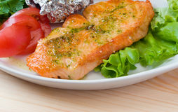 Stake from a salmon with vegetables . Closeup. stock photo