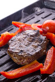 Stake with vegetables on grill Stock Images