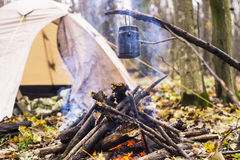 At stake WHO tent in the pot preparing hot water for tea or coffee. A Royalty Free Stock Image
