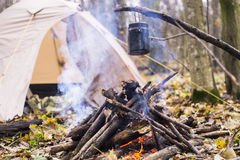 At stake WHO tent in the pot preparing hot water for tea or coffee. A Royalty Free Stock Photo