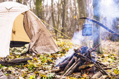 At stake WHO tent in the pot preparing hot water for tea or coffee. A Stock Images