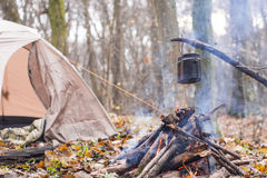 At stake WHO tent in the pot preparing hot water for tea or coffee. A Stock Photography