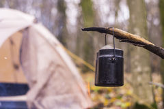 At stake WHO tent in the pot preparing hot water for tea or coffee. A Royalty Free Stock Photography