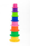 Staked baby cups. Fun tower made of brightly colored plastic cups Royalty Free Stock Photography