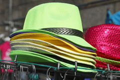 Staked green Hats. On a market stall Stock Photo
