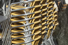 Staked metal chairs. From a restaurant Stock Photo