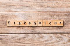 Stakeholder word written on wood block. Stakeholder text on wooden table for your desing, concept.  royalty free stock photography